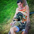 Man in hammock with chihuahua — Stock Photo #53624359