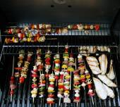 Grill with meat and vegetables on it — Stock Photo