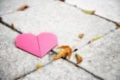 Origami heart on concrete paver blocks — Stok fotoğraf