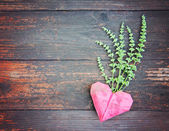 Origami heart on old fence boards — Stock Photo