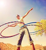 Young man hula hooping — Stock Photo
