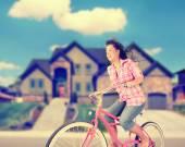 Girl riding her bike — Stock Photo