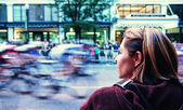 Woman spectator watching bicyclists — Stock Photo