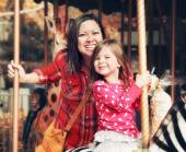 Mother and daughter at park — Stock Photo
