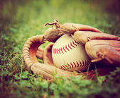 Baseball in old glove — Stock Photo
