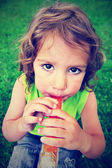 Girl eating a frozen treat — Stock Photo