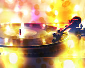 Record player with bokeh lights — Stock Photo