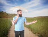 Man under an umbrella — Stock Photo