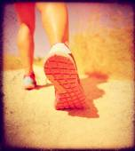 Athletic pair of legs running on path — Foto de Stock