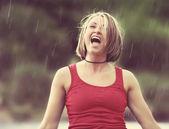 Girl caught in the rain — Stock Photo