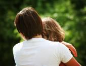 People hugging outside — Stock Photo