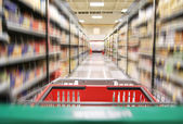 An aisle in a grocery store — Stock Photo