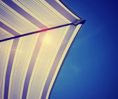 Underside of colorful beach umbrella — Stock Photo