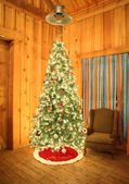 Christmas tree in barn — Stock Photo