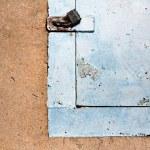 Closed metal door with lock — Stock Photo #53676285