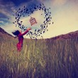 Girl in field tossing birdcage — Stock Photo #54193059