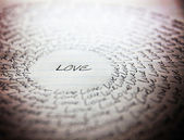 Word love written on lined paper — Stockfoto