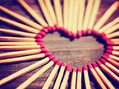 Matchsticks in shape of heart — Stockfoto