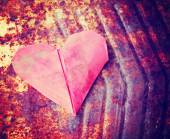Paper heart on rusty background — Stock Photo