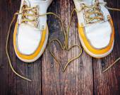 Shoes with laces in heart shape — Stockfoto