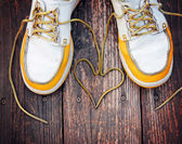 Shoes with laces in heart shape — Stock Photo