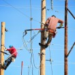 Electrical linemen working — Stock Photo #61016077