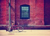 Bike in front of brick wall — Stok fotoğraf