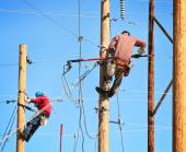 Electrical linemen working — Stock Photo