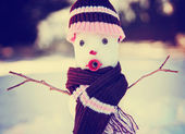 Snowman with hat and scarf — Stock Photo