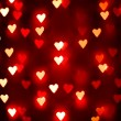 A nice background with defocused lights blurred into the shape of hearts good for holidays like valentine's day or wedding announcements or romantic cards — Stock Photo #62011413