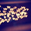 A nice background with defocused lights blurred into the shape of hearts good for holidays like valentine's day or wedding announcements or romantic cards — Stock Photo #62011481
