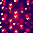 A nice background with defocused lights blurred into the shape of hearts good for holidays like valentine's day or wedding announcements or romantic cards — Stock Photo #62011487
