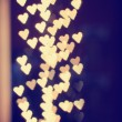 A nice background with defocused lights blurred into the shape of hearts good for holidays like valentine's day or wedding announcements or romantic cards — Stock Photo #62011495