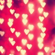 A nice background with defocused lights blurred into the shape of hearts good for holidays like valentine's day or wedding announcements or romantic cards — Stock Photo #62011497