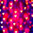 A nice background with defocused lights blurred into the shape of hearts good for holidays like valentine's day or wedding announcements or romantic cards — Stock Photo #62011539