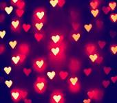 A nice background with defocused lights blurred into the shape of hearts good for holidays like valentine's day or wedding announcements or romantic cards — Stock fotografie