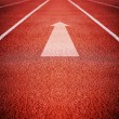 Running Track with an arrow — Stock Photo #67622069