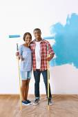 Paint on new apartment for african couple — Stock Photo