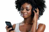 African female listening to music — Stock Photo