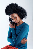 African woman looking contemplative — Stock Photo