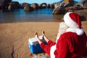 Father Christmas relaxing on the beach — Stock Photo
