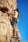 Rock climber with climbing a mountain — Stok fotoğraf