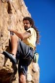 Rock climber on steep mountain — Stock Photo