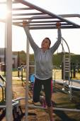 Woman working out at outdoor gym — Stock Photo