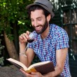 Man outdoors reading book with wine — Stock Photo #74972821