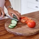 Woman making salad at home — Stock Photo #74973361