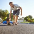 Boy learning to ride skateboard — Stock Photo #74973949