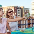 Friends toasting to celebration with drinks — Stock Photo #74979937