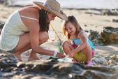 Mother and daughter fishing at beach — Stock Photo