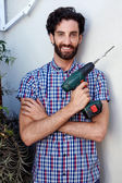 Man using cordless battery drill — Stock Photo